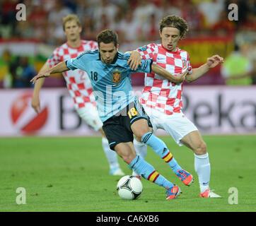 18.06.2012. Gdansk, Poland.  Croatia's Luka Modric (R) and Spain's Jordi Alba vie for the ball during UEFA EURO - Stock Photo