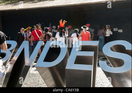 Representatives of indigenous people gain a hearing at BNDES, the Brazilian National Development Bank, after a march - Stock Photo