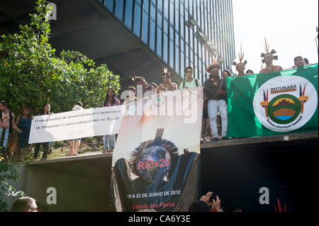 Indigenous people unfurl banners during a protest at BNDES, the Brazilian Development Bank, after a march from the - Stock Photo