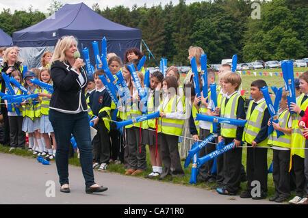 Radio Leeds presenter Georgey Spanswick entertaining & talking to the crowd (schoolchildren) standing & waiting - Stock Photo