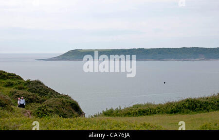 Swansea - UK - 20th June 2012  : A couple walking along the clifftops at Southgate on the Gower Peninsula near Swansea - Stock Photo