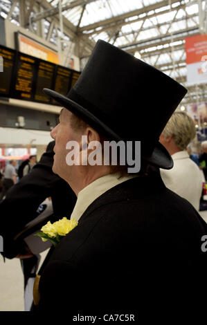 21st June 2012. London UK. Race goer with Top hat at Waterloo Station looks at timetable for trains to Ascot. - Stock Photo