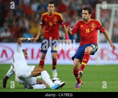 23.06.2012. Donetsk, Ukraine.  Spain's Jordi Alba (R) and France's Yann M'Vila challenge for the ball during the - Stock Photo