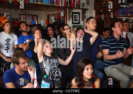 LA PAZ, BOLIVIA, 24th June 2012. A mixture of English travelers, expats and locals watch the European Football Championships - Stock Photo