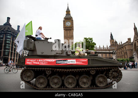 London, UK. Wednesday 27th June 2012. Tank passed through Parliament Square past Big Ben and the Houses of Parliament. - Stock Photo