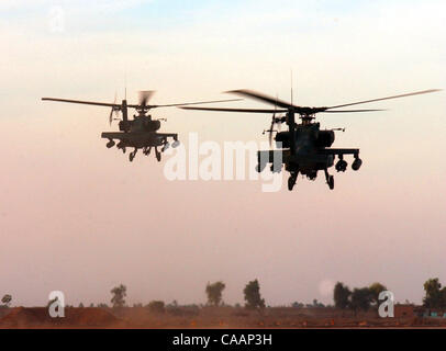 FOR METRO - U.S. Army AH-64D Apache Longbow helicopters leave Camp Anaconda near Balad, Iraq on a patrol December 2003. PHOTO BY EDWARD A. ORNELAS/STAFF Stock Photo