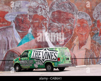 May 08, 2004; Los Angeles, CA, USA; A mural near Hollywood  Blvd. with a van promoting the band 'The Vines' parked - Stock Photo
