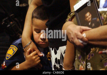 Metro-Jeremy Morales, 5, holds the hand of his mother, Rena Morales, while his grandmother, Candi Godinez, holds - Stock Photo