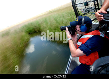 June 11, 2010 - Cocodrie, Louisiana, U.S. - From a speeding air boat, U.S Coast Guard petty officer JOHN MILLER - Stock Photo