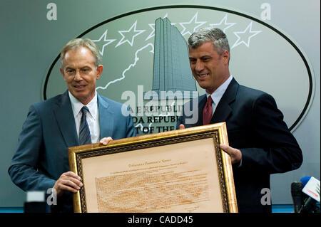 July 08, 2010 - Pristina, Pristina, Kosovo - Britain's former prime minister TONY BLAIR (left) receives framed Kosovo's - Stock Photo