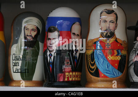 Two in One Matryoshka dolls on sale in St.Petersburg. Matryoshka wooden doll with images of potential next russian - Stock Photo