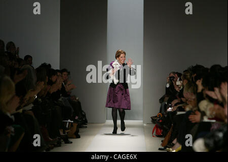 Designer REEM ACRA carries her dog while receiving applause following the REEM ACRA Fall 2008 Fashion Show in New - Stock Photo