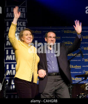 Republican presidential candidate former Arkansas Governor Mike Huckabee arrives with his wife Janet at a final - Stock Photo