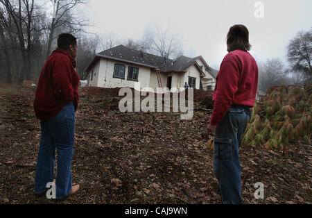 In Rough and Ready, California, Annica Hagadorn and Ray Hagadorn look toward their green home as solar panels are - Stock Photo