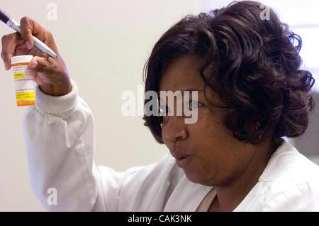 ATLANTA, GA - SEPTEMBER 20:  Grady Memorial Hospital diabetes nurse Pamela Vaughn consults with a patient in the - Stock Photo