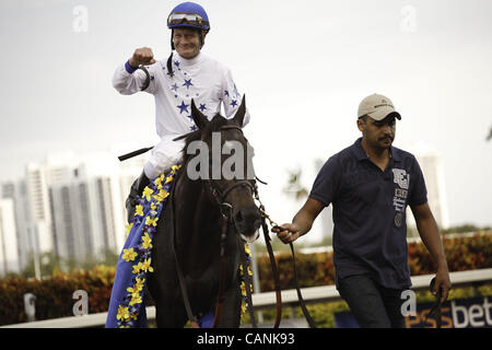 March 31, 2012 - Hallandale Beach, Florida, U.S. - Take Charge Indy with jockey Calvin Borel after winning the Florida - Stock Photo