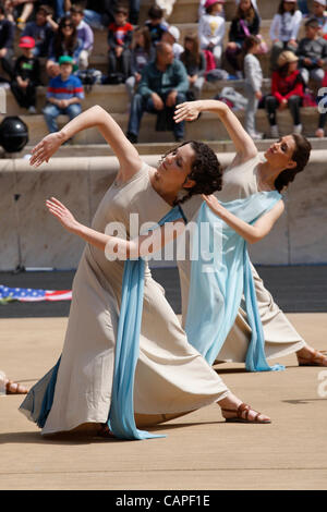 Athens, Greece. Friday, April 6th 2012. Performers at The Panathinaiko Stadium. Thousands of primary and secondary - Stock Photo