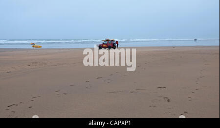 A lonely lifeguard on a cold, rainy, windswept and deserted Summerleaze Beach on  a Bank Holiday Monday at Bude, - Stock Photo