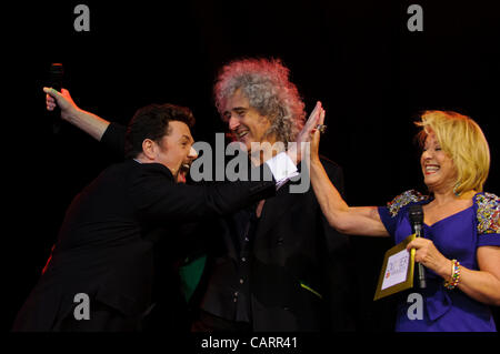 LONDON, Covent Garden, 15 April 2012.  (centre) Brian May (lead guitarist of the rock band, Queen) and (right) Elaine - Stock Photo