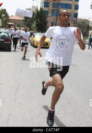 April 19, 2012 - Ramallah, West Bank, Palestinian Territory - Palestinian athletes ran in the Olympic Marathon  - Stock Photo