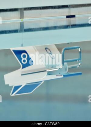 AQUATICS CENTRE, OLYMPIC PARK, LONDON, UK, Sunday. 22/04/2012. Omega Starting Block number eight (8) reflected in the pool water. London Prepares Series. FINA Synchronised Swimming Olympic Qualification.