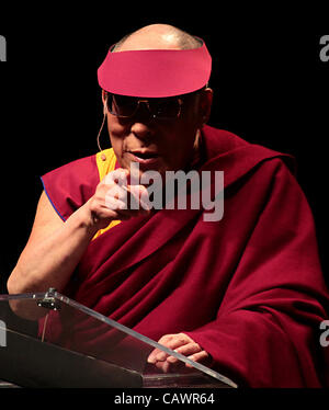 April 28, 2012 - Ottawa, Ontario, Canada - Dalai Lama gestures while he addresses the audience during delivering - Stock Photo