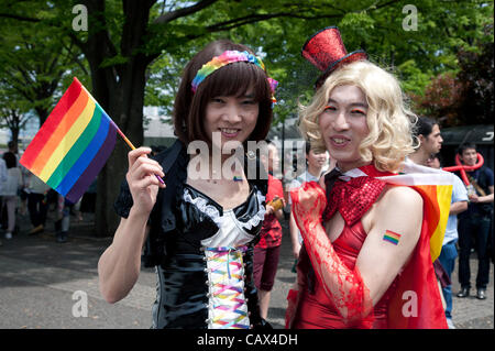 April 29, 2012, Tokyo, Japan -  Two men dressed as women are carrying the rainbow flag. The first Tokyo Rainbow - Stock Photo