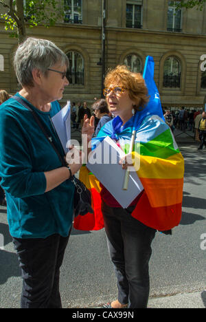 Paris, France, Labor Unions Demonstrate in Annual May Day March, Woman Participant in Gay Peace Flag talking to - Stock Photo