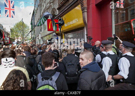 London, UK. 1st May 2012 Protestors gathered at the end of the May Day rally to protest at various sites linked - Stock Photo