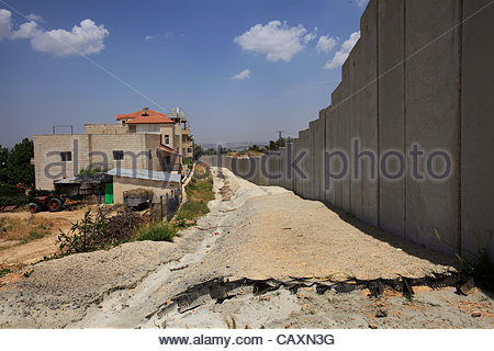 The West Bank separation barrier built by Israel through the Palestinian village of Walaja located between Bethlehem - Stock Photo