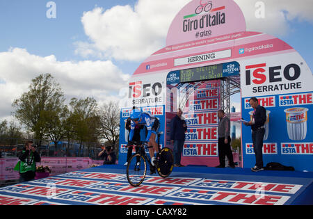 HERNING, Denmark - Saturday, May 5th, 2012: Garmin-Barracuda rider, American Peter Stetina,  rolls down the ramp - Stock Photo
