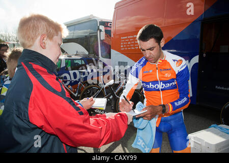 HERNING, Denmark - Saturday, May 5th, 2012: Rabobank rider Juan Manuel Garate Cepa (right) sign autographs to a - Stock Photo