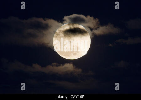Perigree full moon, or supermoon, rises over Colorado, USA. Moon is closer to earth in orbit than normal. - Stock Photo