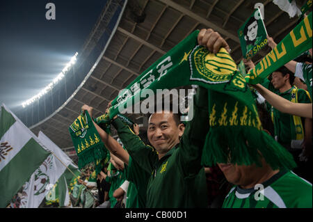 Supporters of Beijing Guoan in the Workers' Stadium during the match between the Beijing Guoan and Guizhou Renhe football teams in Beijing, China, on Friday May 11, 2012. Beijing Guoan won the match with 2:1.