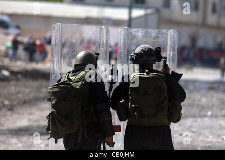 Ramallah, West Bank, Palestinian Territory - Israeli border police fires tear gas towards Palestinian protesters, - Stock Photo