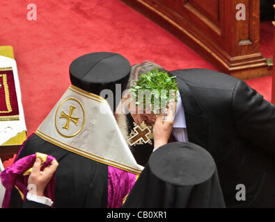 May 17, 2012 - Athens, Greece - Leader of Socialist Party (PASOK), Evangelos Venizelos gets sanctified with Holy - Stock Photo