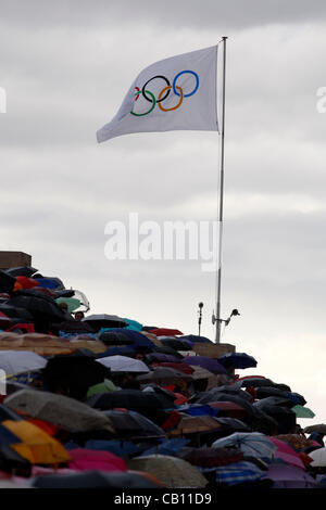 May 17, 2012 - Athens, Greece - Olympic Flame handover ceremony under the rain at the Panathenaic stadium. Greek - Stock Photo