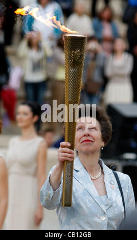 May 17, 2012 - Athens, Greece - Britain's PRINCESS ANNE holds the torch with the Olympic Flame at the handover ceremony - Stock Photo