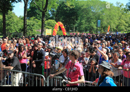 Crowds watch the 27th annual AIDS Walk New York, the world's largest HIV/AIDS fundraising event, Central Park, New York City, USA on Sunday, May 20th, 2012.