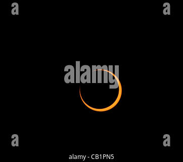 Sunday May 20 2012, exiting total coverage the moon starts to move away from the sun during the annular eclipse - Stock Photo