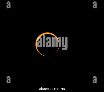 Sunday May 20 2012, the moon nearing maximum coverage of the sun during the annular eclipse. As seen from Rainbow - Stock Photo