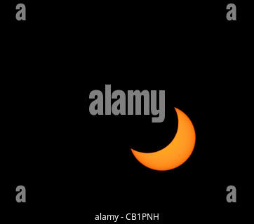 Sunday May 20 2012, past maximum coverage, the moon continues in front of a waxing sun during the annular eclipse - Stock Photo