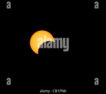 Sunday May 20 2012, the moon passes in front of a waning sun on its path to create an annular eclipse seen at Rainbow - Stock Photo