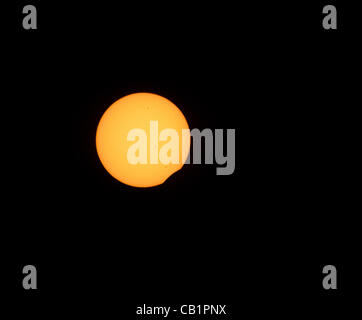 Sunday May 20 2012, the moon starts to pass in front of the sun on its was to create an annular eclipse as seen - Stock Photo