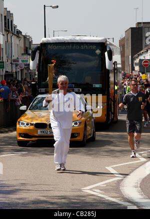 Wednesday, May 23rd 2012.  Swindon, Wiltshire, England, UK. Stephen Ratcliffe carries the Olympic Torch along Commercial - Stock Photo