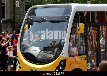 Wednesday, May 23rd 2012.  Swindon, Wiltshire, England, UK. The Olympic Torch Relay coach passes through Bath Road - Stock Photo