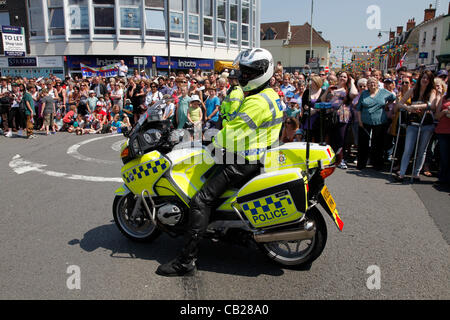 Wednesday, May 23rd 2012.  Swindon, Wiltshire, England, UK. Police patrol bike waits ahead of the Olympic Torch - Stock Photo