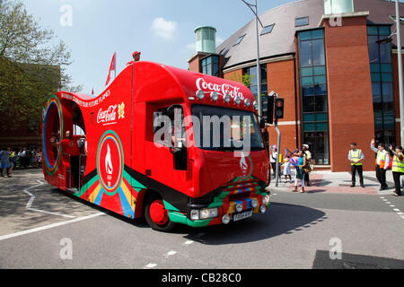 Wednesday, May 23rd 2012.  Swindon, Wiltshire, England, UK. The Coca-Cola coach signals the imminent arrival of - Stock Photo