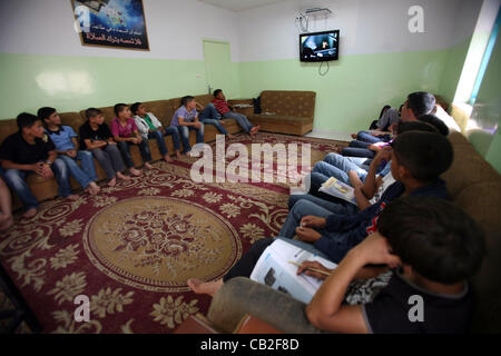 May 22, 2012 - Hebron, West Bank, Palestinian Territory - Palestinian orphan children watch TV at the Hebron's orphan - Stock Photo