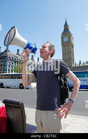 London, UK. Saturday 26th May 2012. Peter Tatchell talking at Parliament Square, Westminster, before UK Uncut hold - Stock Photo